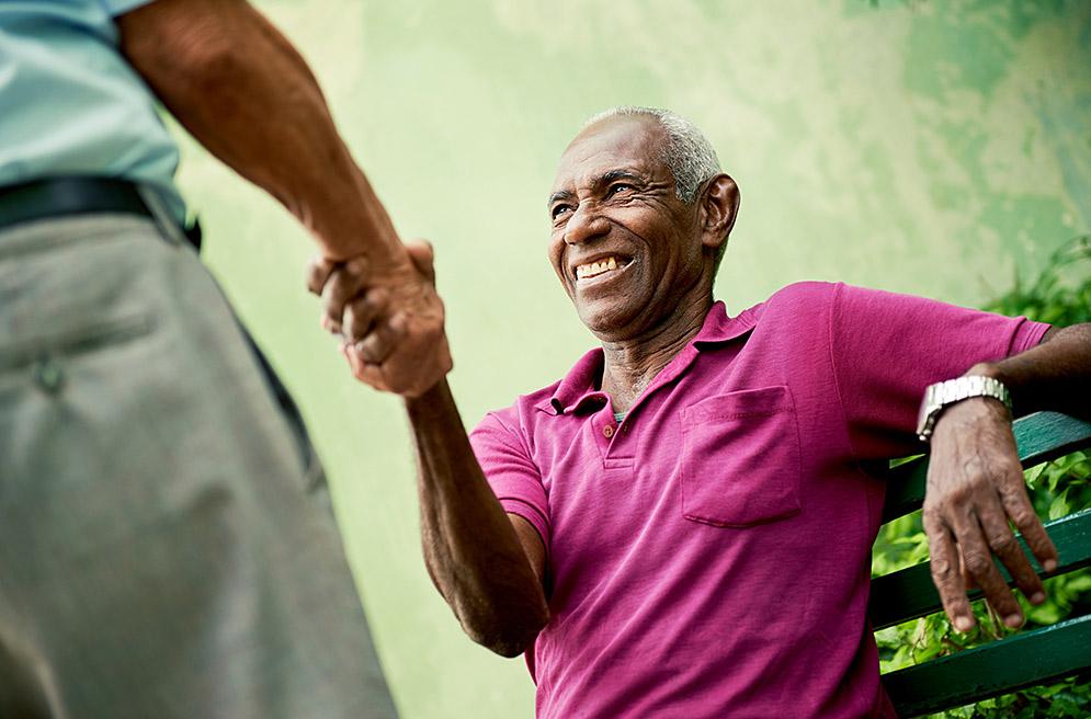 Senior man shaking hands
